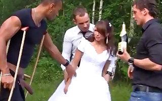 Russian bride enjoys an interracial gang-bang outdoors